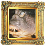 picture of a very ugly fish in an elaborate gilded frame